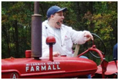 Ken Lindsay selling a McCormick-Deering Farmall tractor at a Michigan public auction.