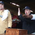 Professional Auctioneer, Kenny Lindsay calling the bids